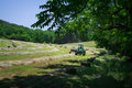 Farmer bales hay a his field using tractor Royalty Free Stock Photos