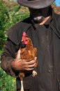 Farmer with chicken Royalty Free Stock Photo