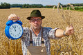 Farmer with Clock 11:55 Royalty Free Stock Photography