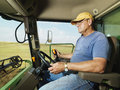 Farmer in combine Stock Image