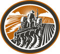 Farmer driving tractor plowing field retro illustration of a worker a vintage farm set inside oval shape done in woodcut style on Royalty Free Stock Image