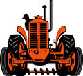 Farmer driving vintage tractor Royalty Free Stock Photo