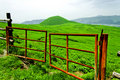 Farmer gate and super green volcano landscape Stock Images