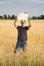 Farmer Guy in Wheatfield Holding Blank Sign Stock Photos