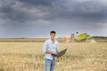 Farmer with laptop in the field Royalty Free Stock Photo
