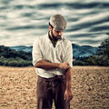 Farmer of the late nineteenth century shorten the sleeves in field Royalty Free Stock Photos