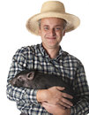Farmer with a little black pig Stock Photos
