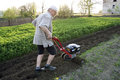 The farmer with a motor-cultivator Stock Photography