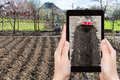 Farmer photographs the plowing of garden ground Royalty Free Stock Photo