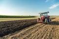 Farmer Plowing Stubble Field W...