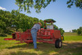 Farmer prepares equipment a his hay baling for work Royalty Free Stock Photography