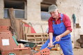 Farmer repairing his red tractor model is real Royalty Free Stock Photos