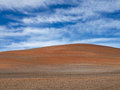 A farmer s plowed field in the country ploughed furrows farmers Royalty Free Stock Images