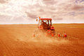 Farmer sowing crops at field filtered image to emulate xpro look Stock Photo