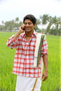 Farmer talking in his cell phone Royalty Free Stock Image
