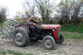 Farmer on a tractor old cramps stubble his field in serbia preparing the country for the autumn plowing Stock Photography