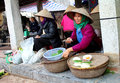 Farmer woman selling rice cakes hai duong vietnam april in gold market on april in thanh ha hai duong vietnam this is the oldest Royalty Free Stock Photography
