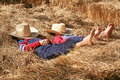Farmers Asleep in the Hay Royalty Free Stock Photo