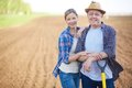 Farmers on the field image of two happy background of plowed Stock Photos