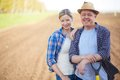 Farmers on the field image of two happy background of plowed Stock Photo