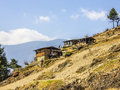 Farmers houses bhutan on a steep mountainside the sky is blue Royalty Free Stock Images