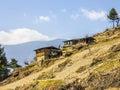 Farmers houses bhutan on a steep mountainside the sky is blue Royalty Free Stock Images