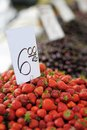 Farmers market fresh strawberries at Royalty Free Stock Photo
