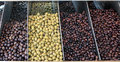 Farmers market heap of fresh mediterranean olives at in greece Stock Photo