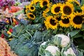 Farmers market stall with vegetables and sunflowers. Royalty Free Stock Photo