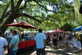 Farmers market vendor booths and people in orlando s eola park downtown Royalty Free Stock Image