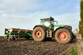 Farmers tractor working on field Royalty Free Stock Photo