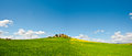 Farmhouse green sloping meadows tuscany Stock Image