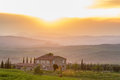 Farmhouse in sunset Royalty Free Stock Photo