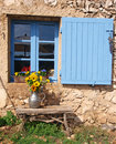 Farmhouse window with blue shutter Royalty Free Stock Photos