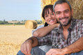 Farming couple sat by hay Royalty Free Stock Photo