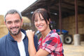 Farming couple stood by their farm Royalty Free Stock Photography