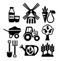 Farming harvesting and agriculture icons set of mill tractor wheelbarrow spade isolated vector illustration Royalty Free Stock Image