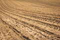 Farmland plowed soil in early springtime Stock Photos