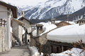 Farmsteads in the snow a group of national park gran paradiso cogne aosta Royalty Free Stock Photo