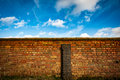 Farmyard wall and sky Royalty Free Stock Photo