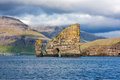 Faroe, natural rock arch through a sea stack Stock Photos