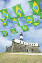 Farol da barra salvador brazil lighthouse brazilian flags portrait of the with flag bunting Stock Photo