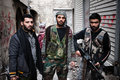 Fas fighters aleppo syria three members of the fsa free syrian army near the frontlines of the old city Royalty Free Stock Photography