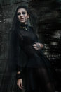 Fashiom model dressed in gothic style. Vamp. Royalty Free Stock Photo