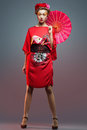 Fashion asian woman wearing traditional japanese red kimono umbrella studio shot geisha Stock Photos