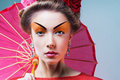 Fashion asian woman wearing traditional japanese red kimono umbrella studio shot geisha Royalty Free Stock Photo