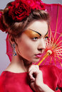 Fashion asian woman wearing traditional japanese red kimono umbrella studio shot geisha Royalty Free Stock Images