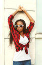 Fashion beautiful african woman wearing a red checkered shirt Royalty Free Stock Photo