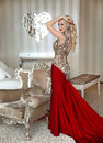 Fashion beautiful blond Girl model with elegant hairstyle in red Royalty Free Stock Photo