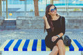 Fashion beautiful on the colored bench Royalty Free Stock Photo